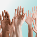 hands raised against blue background