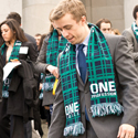 man in suit wearing green scarf