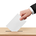 hand dropping ballot into box